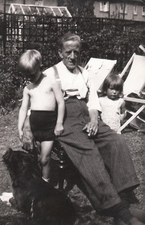 William George Moore in his back garden in Tooting with his grandson John and Grand daughter Hazel